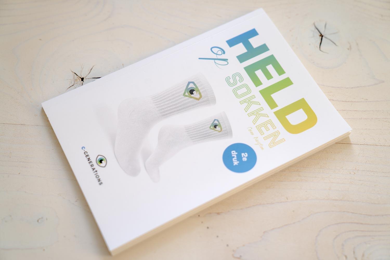 De cover van het boek Held op sokken