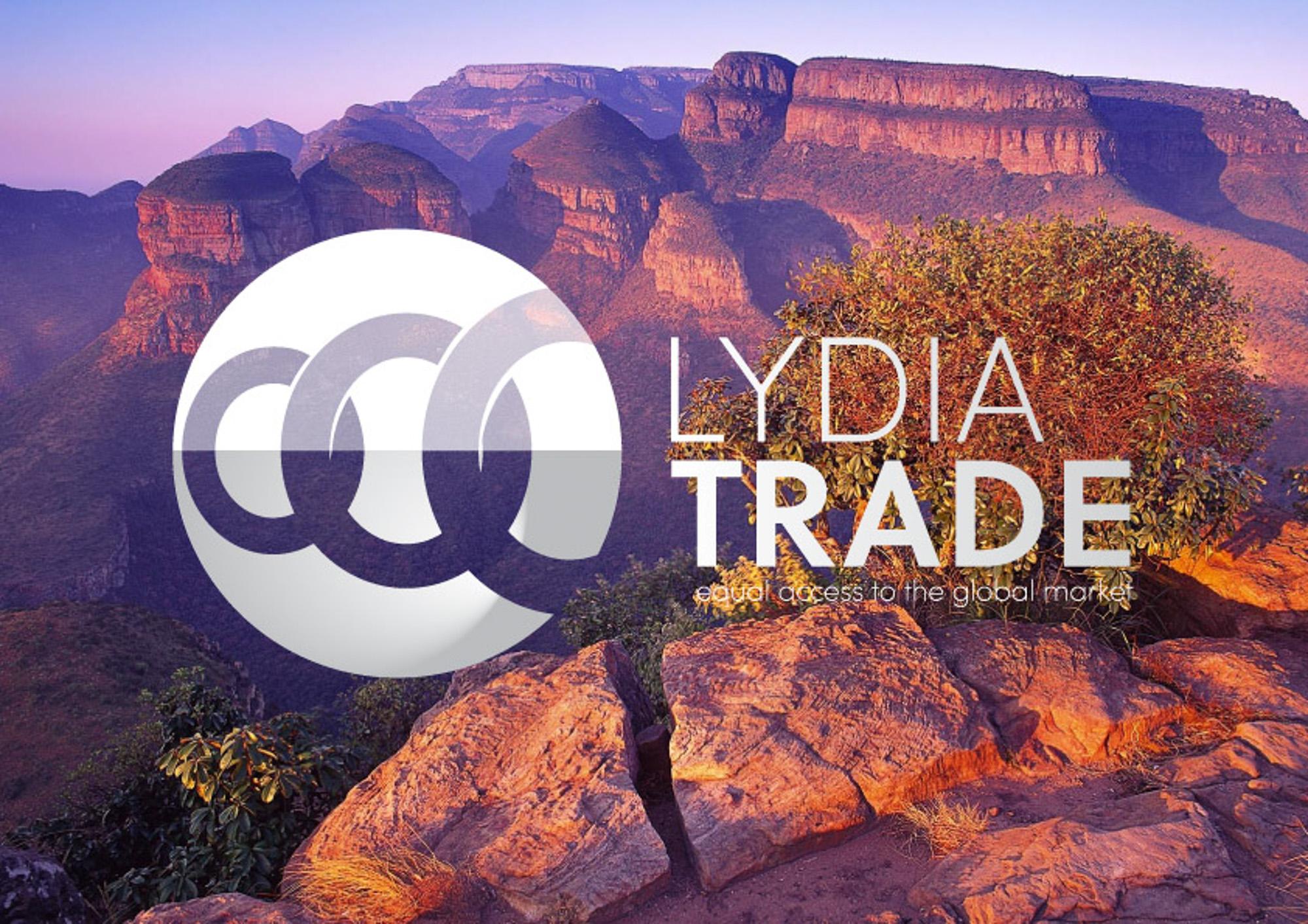 Het logo van Lydia Trade met op de achtergrond een gebergte